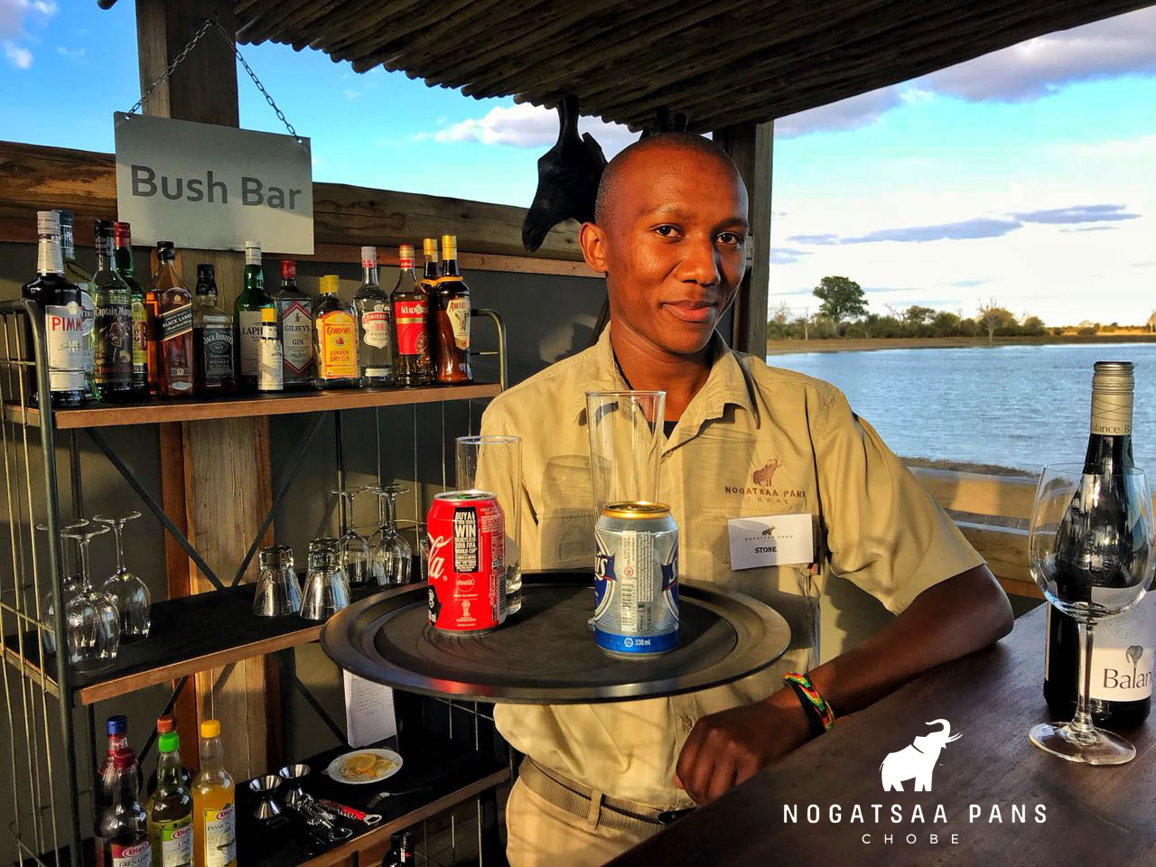 Stone-Proudly-serving-drinks-from-the-Bush-Bar-Nogatsaa-Pans