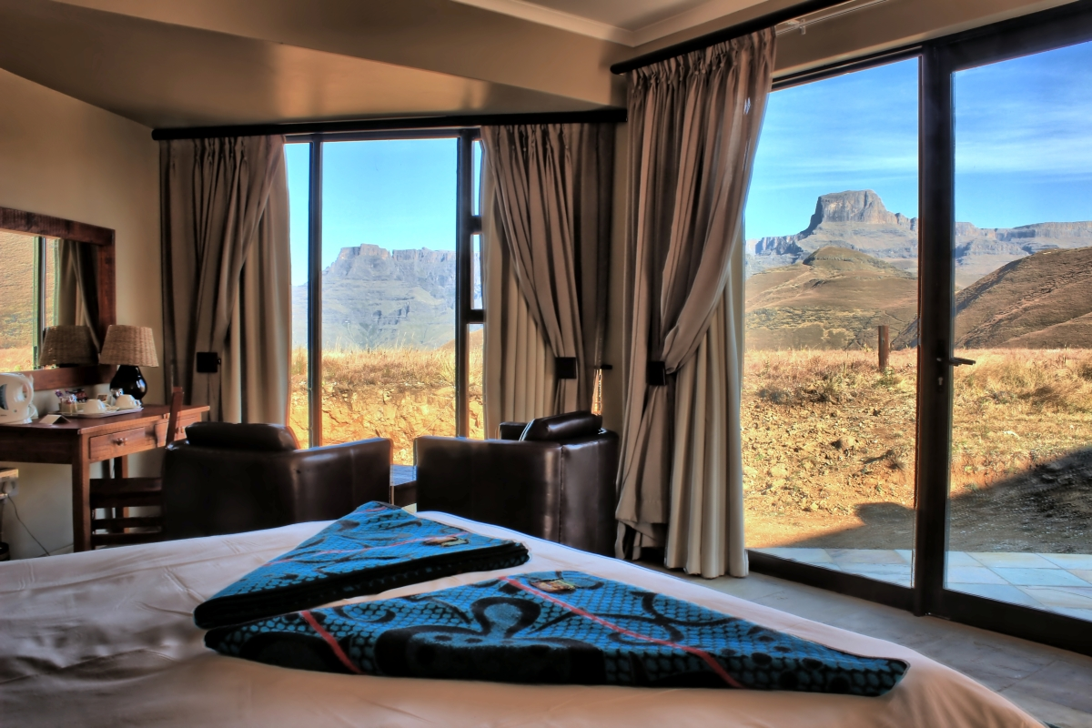 Winter view of the Drakensberg's Ampitheatre from the bed.JPG